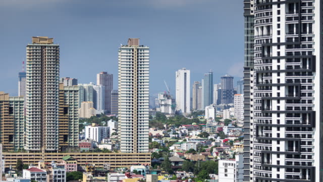 manila apartment buildings and houses - time lapse - manila philippines stock videos and b-roll footage