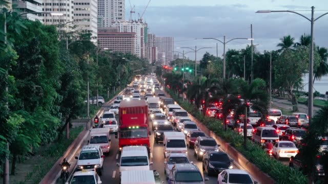 manila bay, cars running along the busy roxas boulevard - manila philippines stock videos and b-roll footage