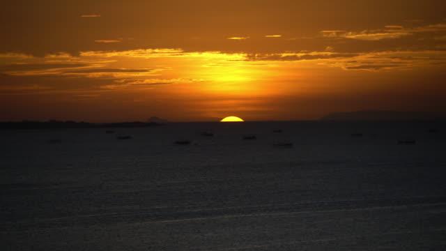 Manila Bay sunset dipping below the horizon