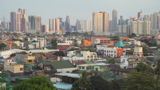manila city iconic image of the skyline, philippines. skyscrapers and slums in the same high angle shot - slum stock-videos und b-roll-filmmaterial