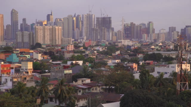 manila city skyline, philippines. skyscrapers and slums in the same high angle shot - contrasts stock videos & royalty-free footage
