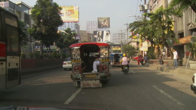 POV of Manila downtown city traffic