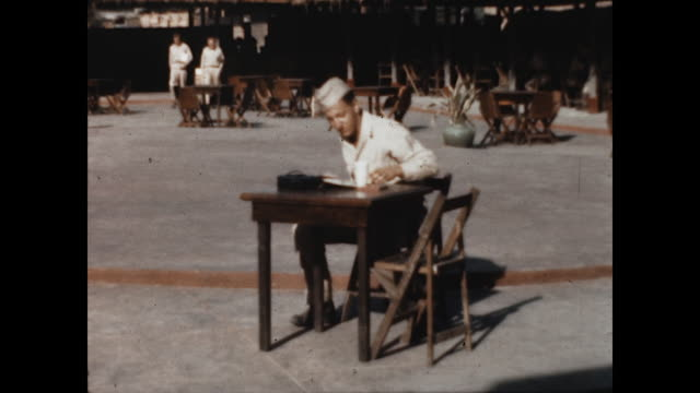 manila post exchange with an american gi taking a break at one of the tables. - 1946 stock videos & royalty-free footage