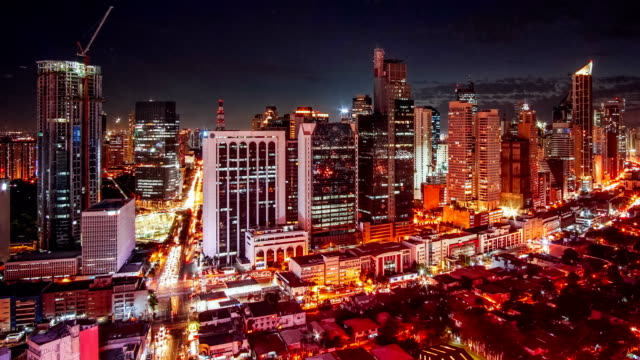 manila timelapse view over makati skyline, metro manila - philippines - filippine video stock e b–roll