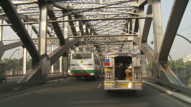 POV of Manila traffic crossing bridge
