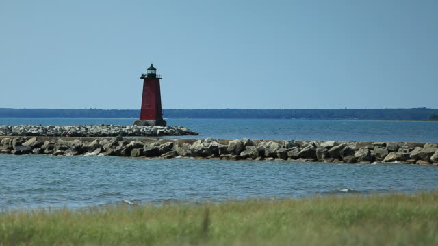 manistique east breakwater, mi - horizon over land stock videos & royalty-free footage