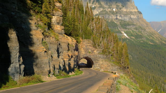 A man-made tunnel carved into the rock marks Logan's Pass at Glacier National Park.