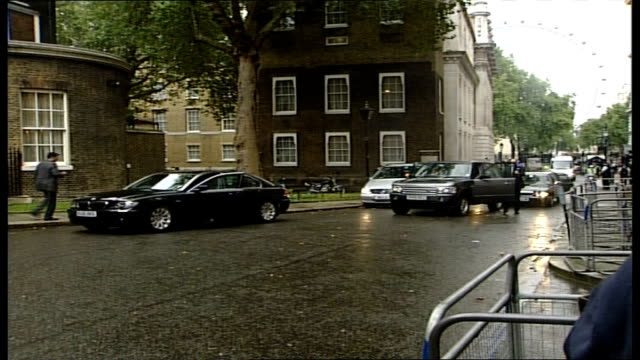 Manmohan Singh greeted by Tony Blair ENGLAND London Downing Street No 10 EXT Entourage of cars along into Downing Street / Indian Prime Minister...
