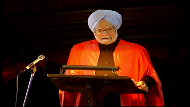 manmohan singh receives honorary degree; manmohan singh , wearing red traditional robe and blue turban, speaking at podium sot - on defeating... - fundamentalism stock videos & royalty-free footage