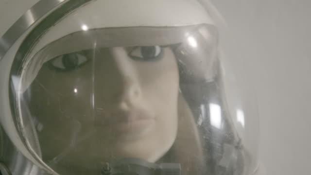 Mannequin in old astronaut suit, tilt up