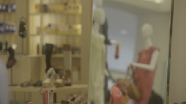 mannequins and shelves display shoes and clothing at barney's new york clothing store in beverly hills, california. - mannequin stock videos & royalty-free footage