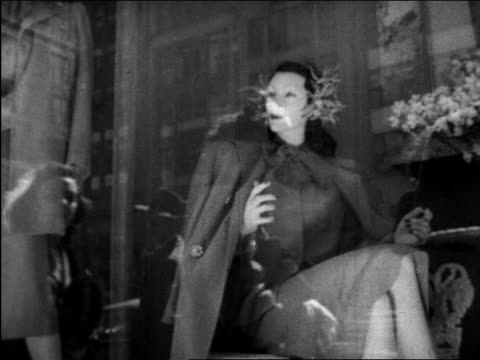 b/w 1945 mannequins in store window with reflection of women window shopping / nyc / educational - clothes shop stock videos & royalty-free footage
