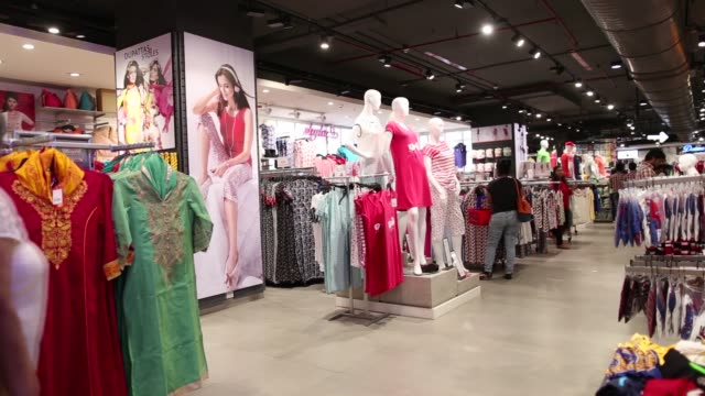 Mannequins model for clothing in Big Bazaar and FBB in a mall in Mumbai India on April 17 2017 Shots wide shot of graphic tee shirt section as...