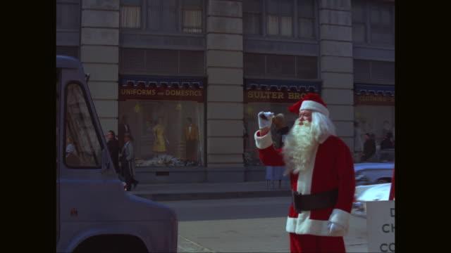 MS ZO Mannequins on window display, Santa Claus ringing bell on sidewalk / Denver, Colorado,  United States