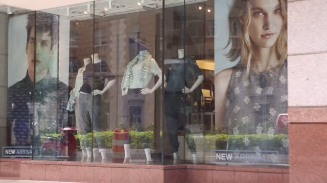 mannequins wearing gap inc track pants stand in a window display at a gap store in washington dc us pedestrians walk past a gap inc store in... - window display stock videos and b-roll footage