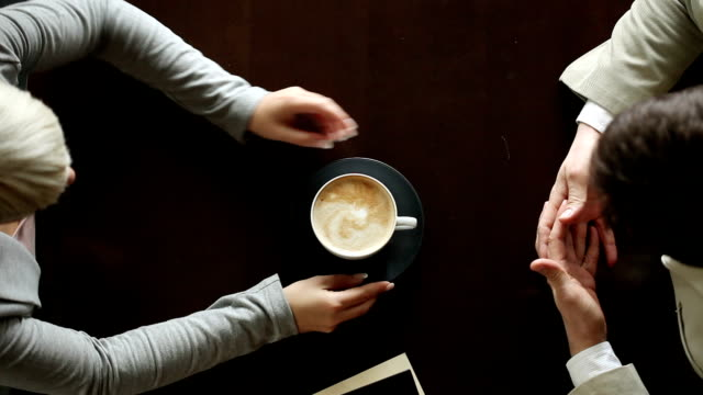 man's and female hold one cup of coffe - hoozone stock videos and b-roll footage