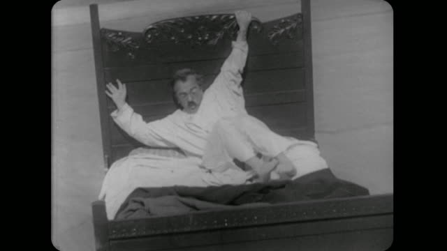 1928 man's animated bed gallops down the street - 1928 stock videos & royalty-free footage
