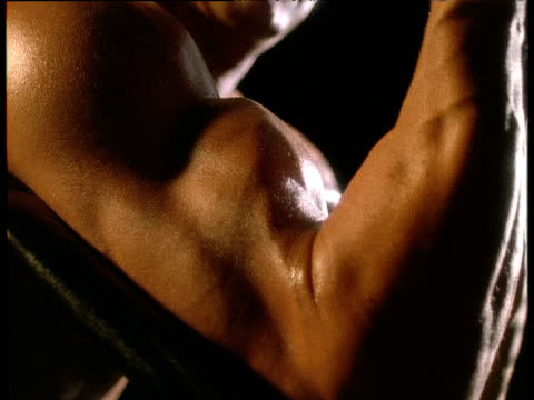 man's biceps contract as he lifts weights - bicep stock videos and b-roll footage
