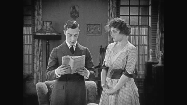 1920 man's (buster keaton) declaration of love is overheard by his love interest - 盗み聞き点の映像素材/bロール