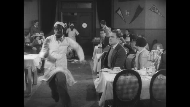 stockvideo's en b-roll-footage met 1927 man's (buster keaton) disguise fails him - racisme