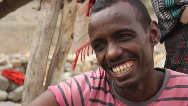 man's face with pointed teeth - エチオピア点の映像素材/bロール