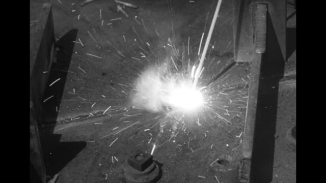 cu man's feet in boots as sparks fly around them from his welding torch / tilt up to torch cutting through metal plate / cu welder using torch /... - dry dock stock videos & royalty-free footage