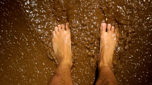 man's feet on sandy beach - water's edge stock videos & royalty-free footage