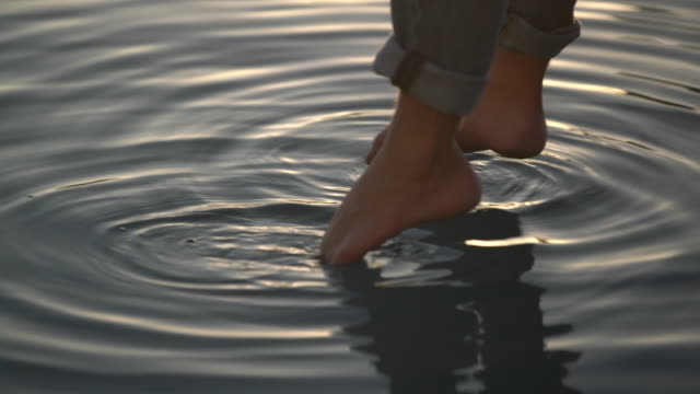cu sm man's feet relaxing in the water - dipping stock videos & royalty-free footage