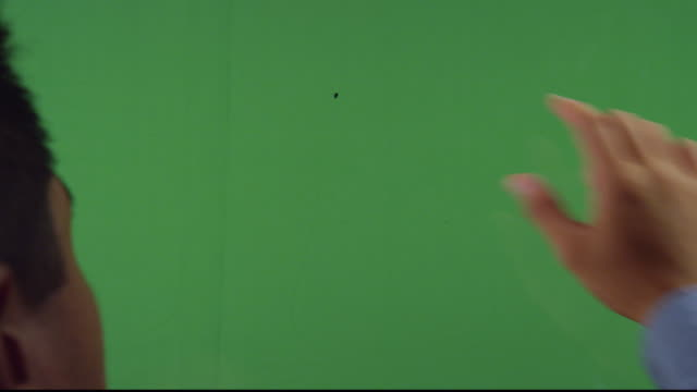 ots cu man's fingers pinching open over green screen - pinching stock videos & royalty-free footage
