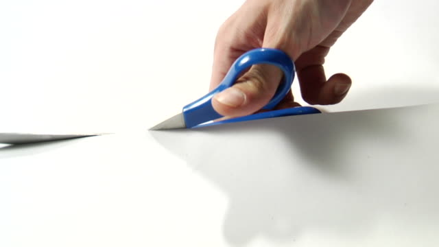 cu, man's hand cutting paper with scissors - schere stock-videos und b-roll-filmmaterial