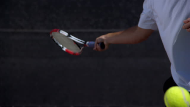 slo mo, cu, man's hand hitting tennis ball with racket, santa barbara, california, usa - tennis racket stock videos & royalty-free footage
