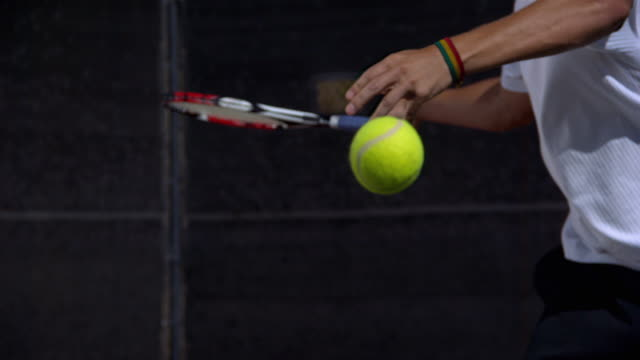 vídeos de stock e filmes b-roll de slo mo, cu, man's hand hitting tennis ball with racket, santa barbara, california, usa - bola de ténis