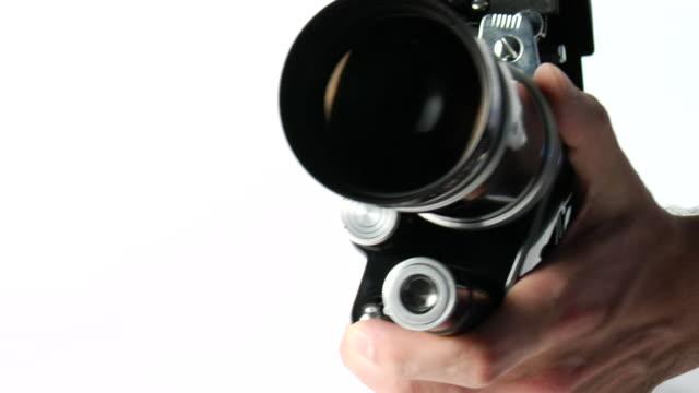 ECU, Man's hand holding 16mm camera