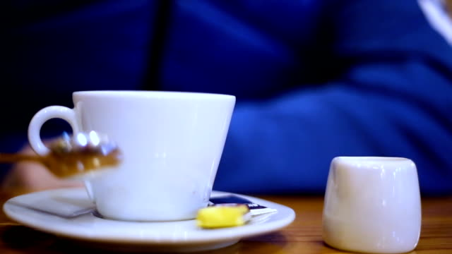 Man's hand holding a coffee cup
