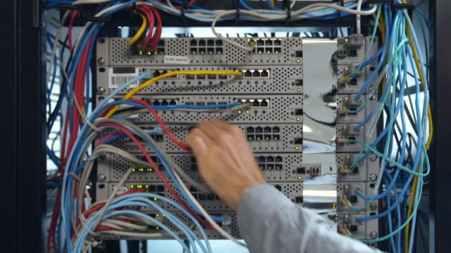t/l cu man's hand inserting cable into back of server, sydney, australia - inserting stock videos & royalty-free footage
