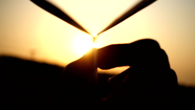 man's hand of launch paper plane against the sun - silhouette stock videos & royalty-free footage