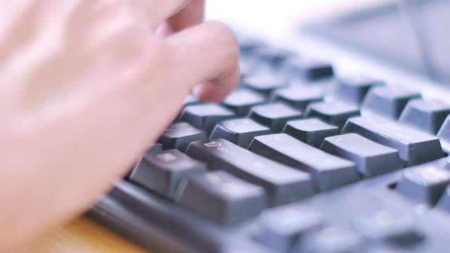 man's hand on computer keyboard