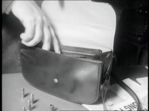 a man's hand opens a purse and takes out a luger automatic pistol - handgun stock videos & royalty-free footage