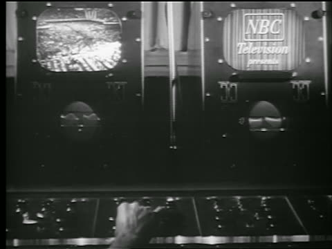 b/w 1948 man's hand operates control panel in foreground / 2 tv screens with nbc logo in background - television show stock videos and b-roll footage