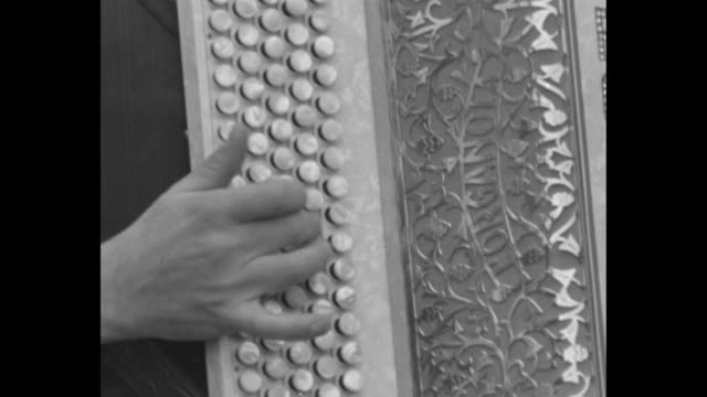 vídeos de stock e filmes b-roll de man's hand playing accordion as people around him sing, tilt up to man's face / note: exact day not known - acordeão instrumento