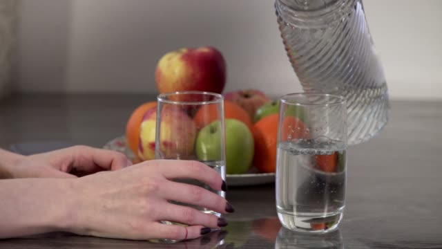 man's hand pours water - decanter stock videos & royalty-free footage