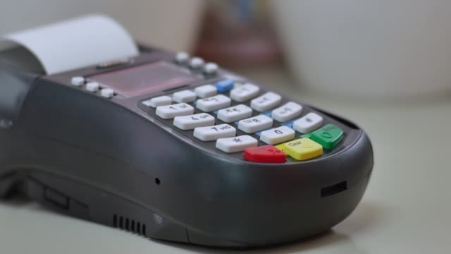 man's hand pushing the button and swipe credit on terminal standing in shopping mall - punch card reader stock videos & royalty-free footage