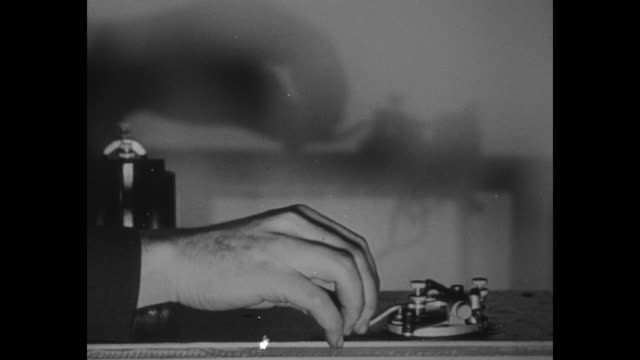 man's hand sends message on telegraph / note exact year not known documentation incomplete - telegraph machine stock videos & royalty-free footage