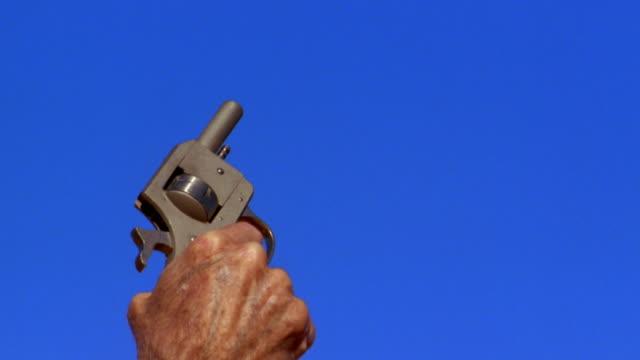 a man's hand shoots a starter pistol. - pistol stock videos & royalty-free footage