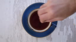 A Mans Hand Stirring tasty Cup of tea 4K Video