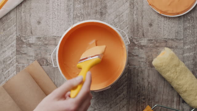 man's hand taking paint from the bucket with paintbrush - decorating stock videos & royalty-free footage