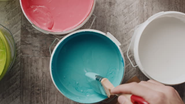 man's hand taking paint from the bucket with paintbrush - paintings stock videos & royalty-free footage