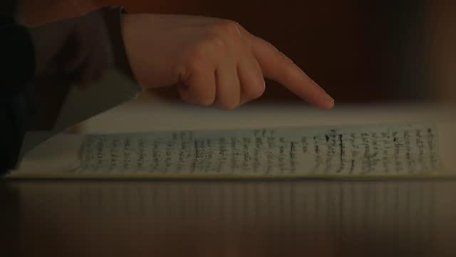 mans hand traces original manuscript of 'frankenstein' - book stock videos & royalty-free footage