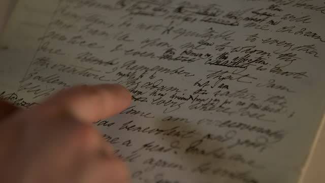 mans hand traces original manuscript of 'frankenstein' - human finger stock videos & royalty-free footage