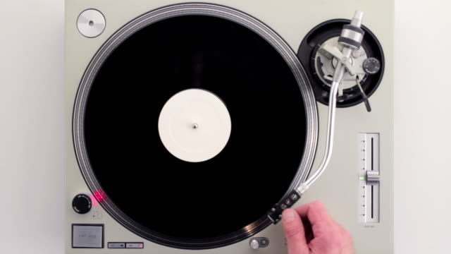 cu ha man's hand turning on and placing needle on disk / london, united kingdom - record player stock videos & royalty-free footage